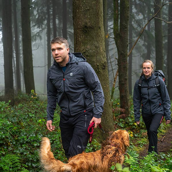 Man and Woman Hiking through a forest