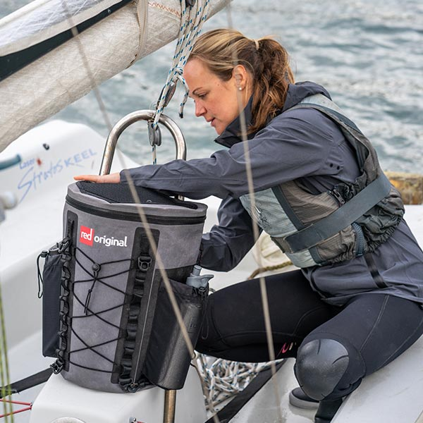 Woman on a sailing yacht getting something from a deck bag