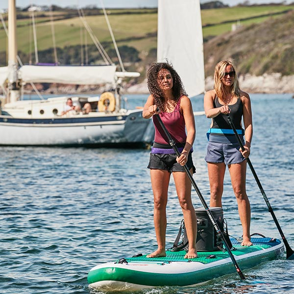 Two women on a Red Paddle Co Tandem SUP