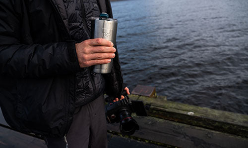 Jay Haysey staying hydrated on location with the Red Original insulated travel cup