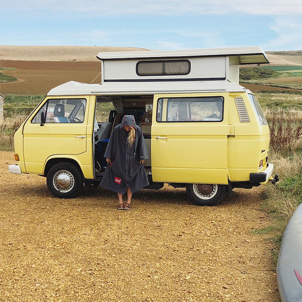 Woman Standing Outside her Campervan