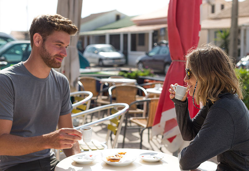 A Couple Enjoying A Bite At An Outdoor Cafe
