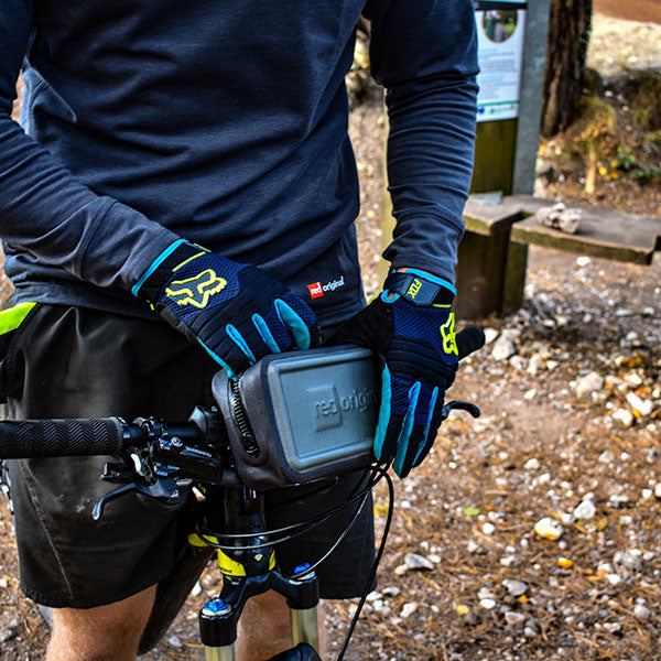 A waterproof pouch attached to a bicycle handlebars