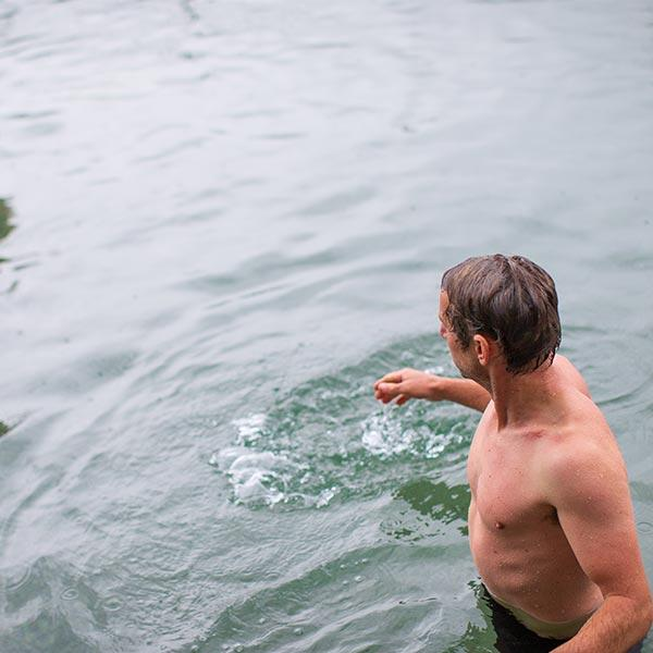 Man Standing In Shallow Open Water
