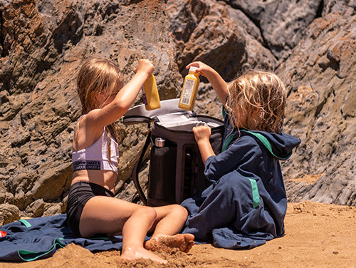 Kids getting drinks out of a Red Original Insulated Cooler Backpack