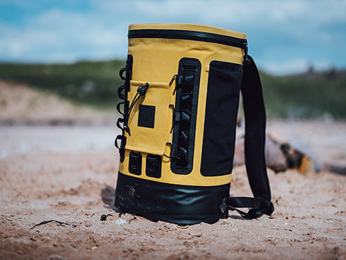 Red Original Insulated Cooler Backpack on the beach