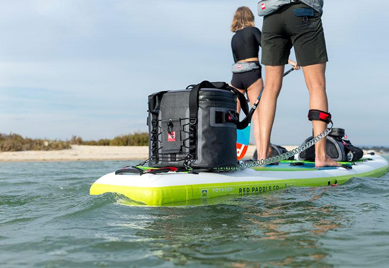 Paddle Boarding With A Cooler Bag Strapped To The SUP