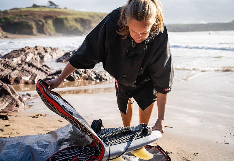 getting surf board out wearing Red Original Women's Short Sleeve Pro Change Robe - Black with Grey Lining