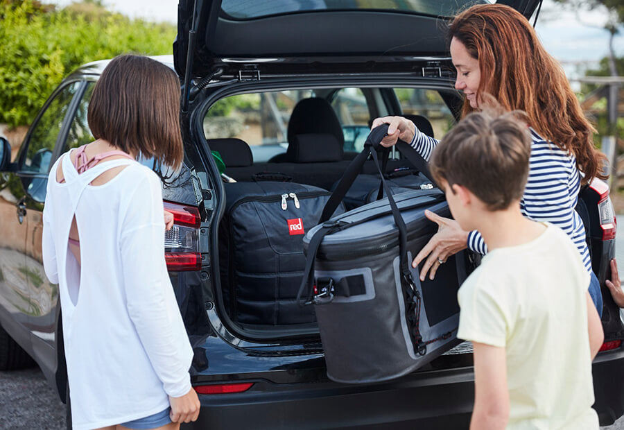 Family Loading A Cooler Bag Into Their Car
