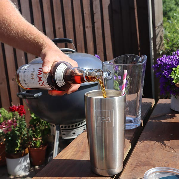 Pouring Pimms Into th Travel Cup