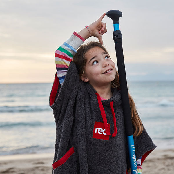A child wearing the Red Original Luxury Towelling Robe
