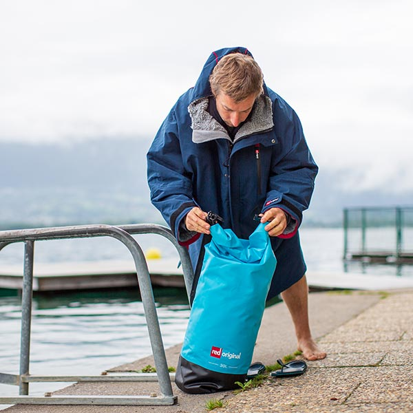 The Red Original Waterproof Rolltop bag strapped to an inflatable stand up paddle board