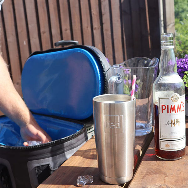Man making a pimms in the garden