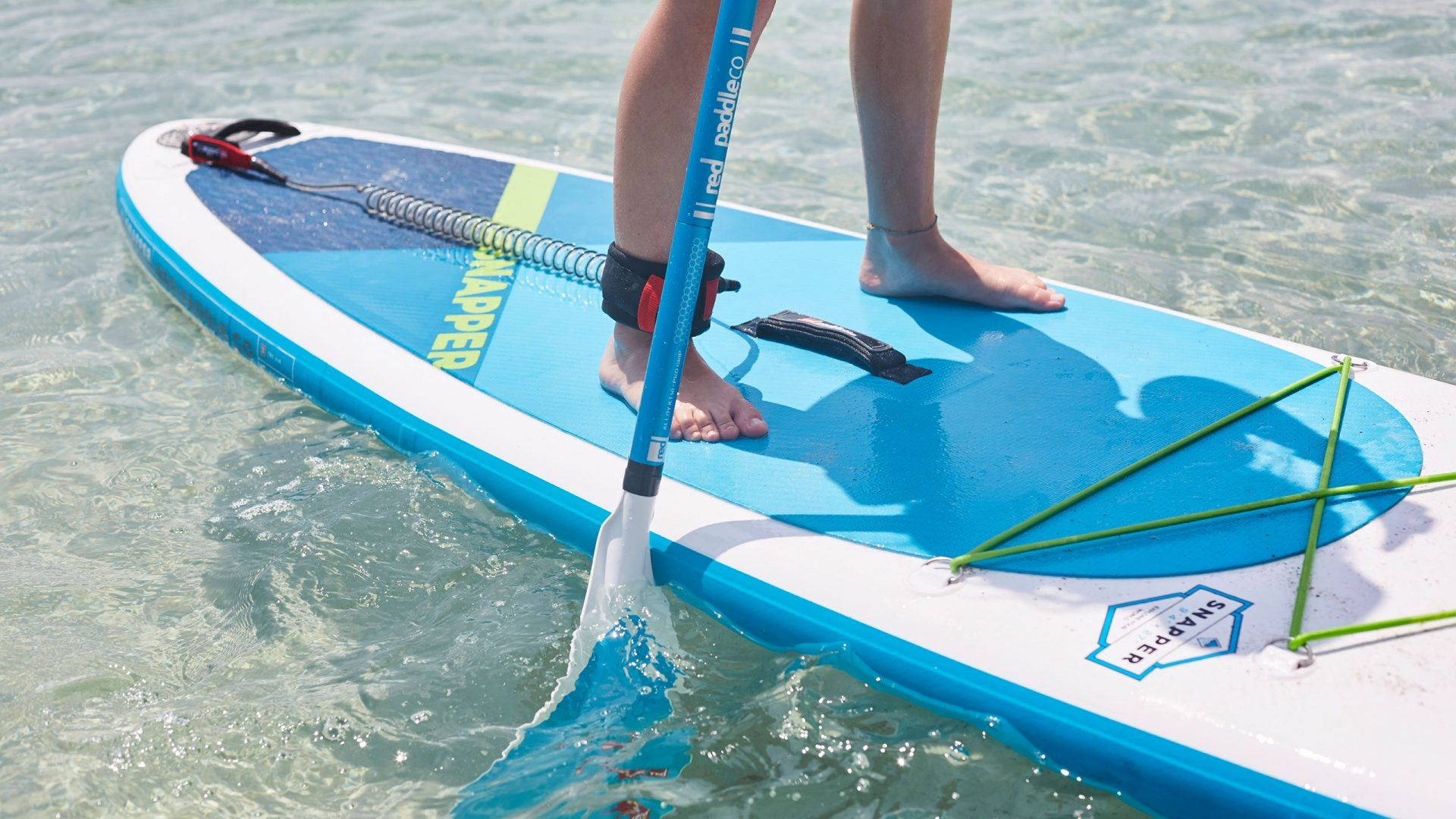 Kid Paddle Boading With SUP Leash Round Their Ankle
