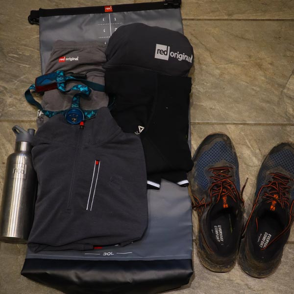 Running equipment laid out on floor.