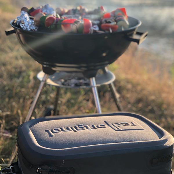 red original cooler bag being used for a bbq