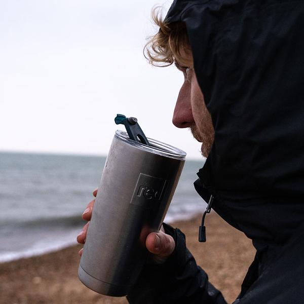 Man By The Sea Drinking From A Red Original Insulated 316L Stainless Steel Travel CUp