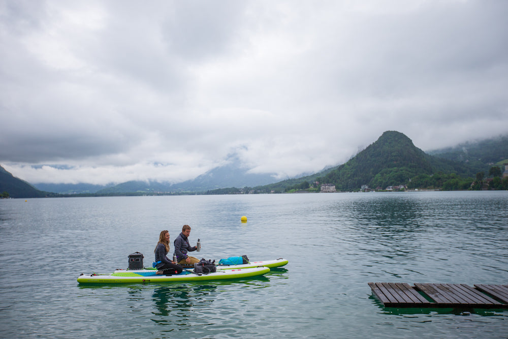 Couple paddle boarding in Lake Annecy