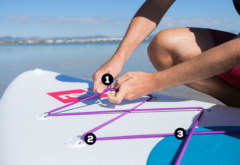red original bungee cord attached to board