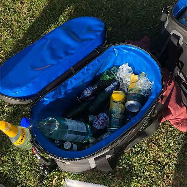 Ice, Beers, Cider And Soft Drinks In A Waterproof Cooler Bag