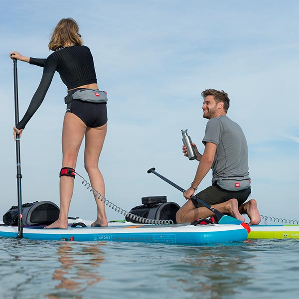 Man and Woman Paddle Boarding