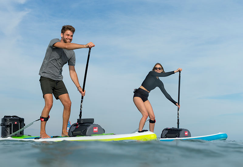 Couple paddle boarding wearing Red Original Mens Performance T Shirt