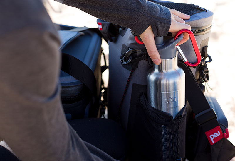 The Red Original Insulated Steel Water Bottle Placed In The Side Pocket Of A Deck Bag