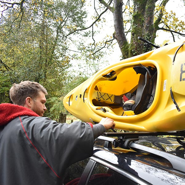 Ross Tying a Kayak to his Car