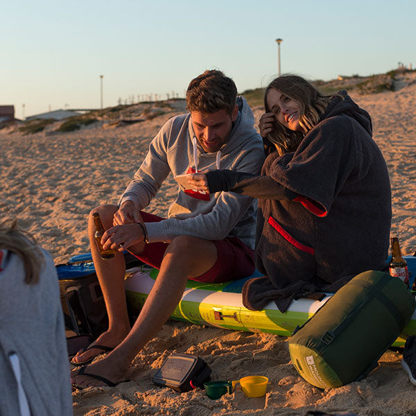 Man and woman at the beach wearing a luxury towelling robe