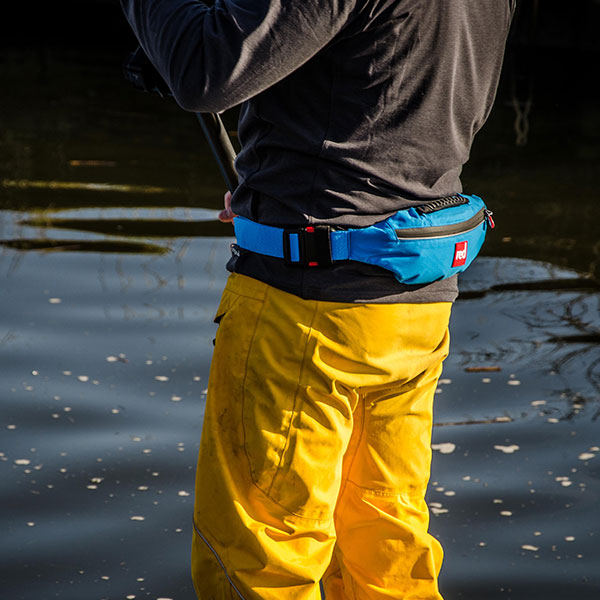 Man paddle boarding wearing dry trousers.