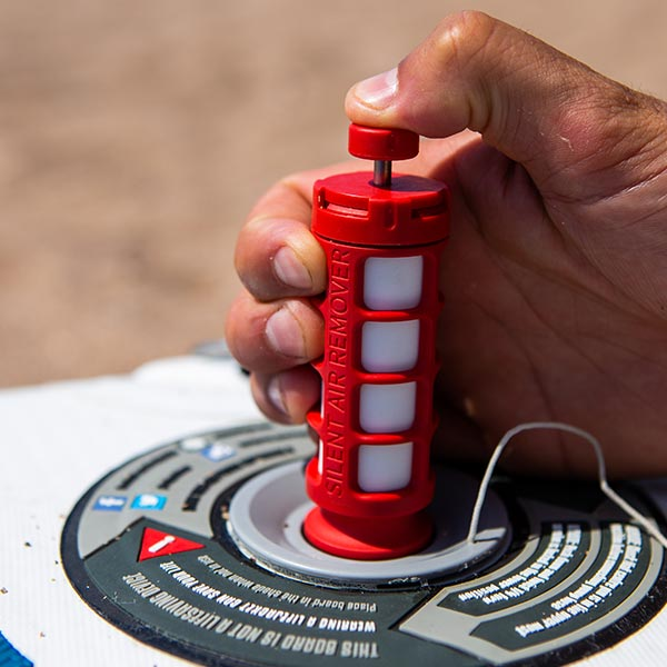 The Red Original Silent Air Remover removing air from a paddle board