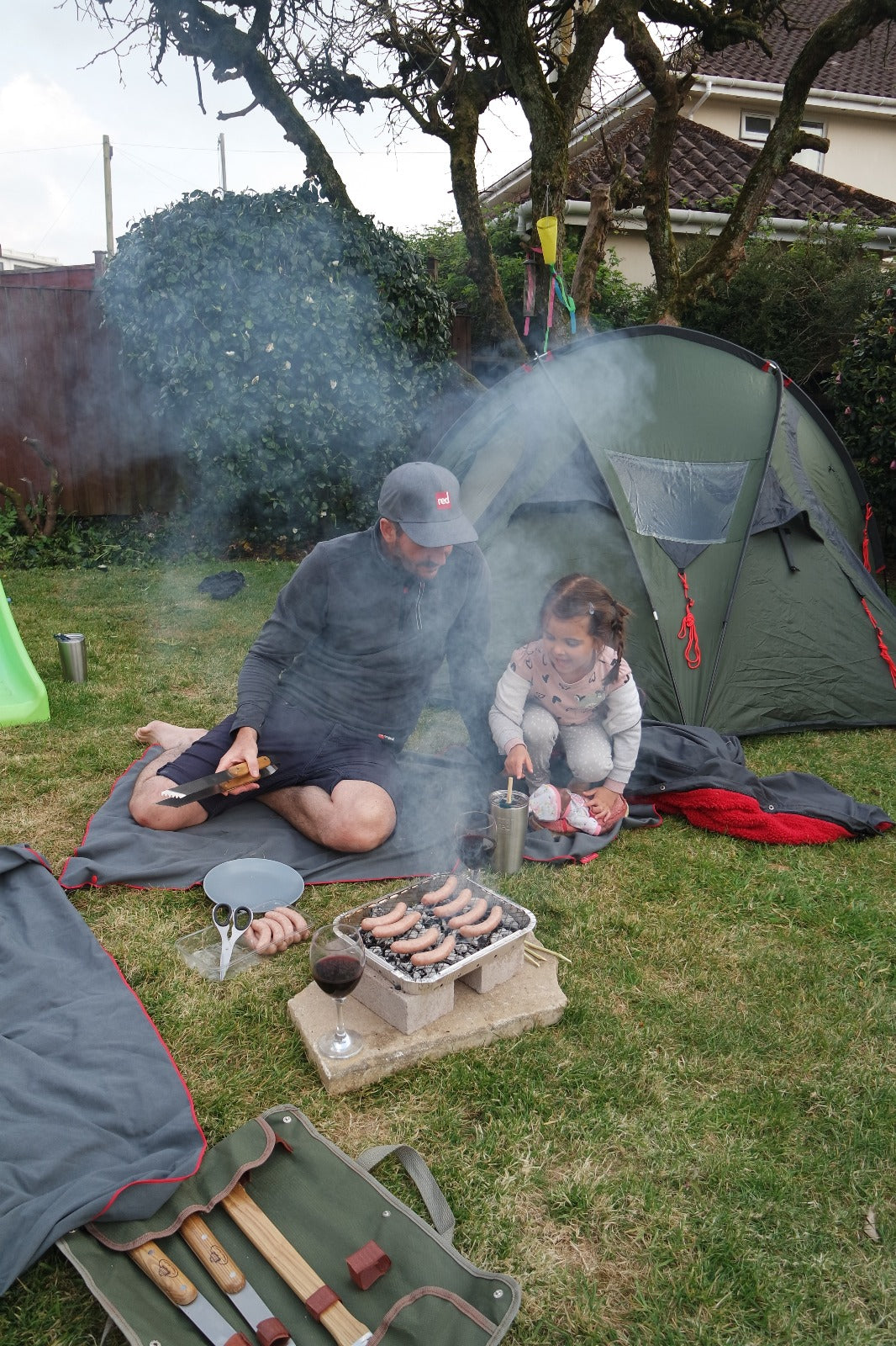 Camp site in the back garden with father and daughter