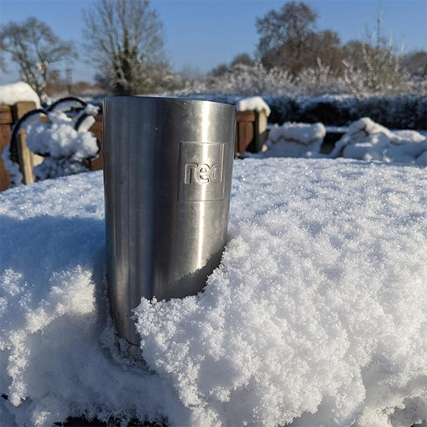 Red Original Insulated Stainless Steel Travel Cup In The Snow