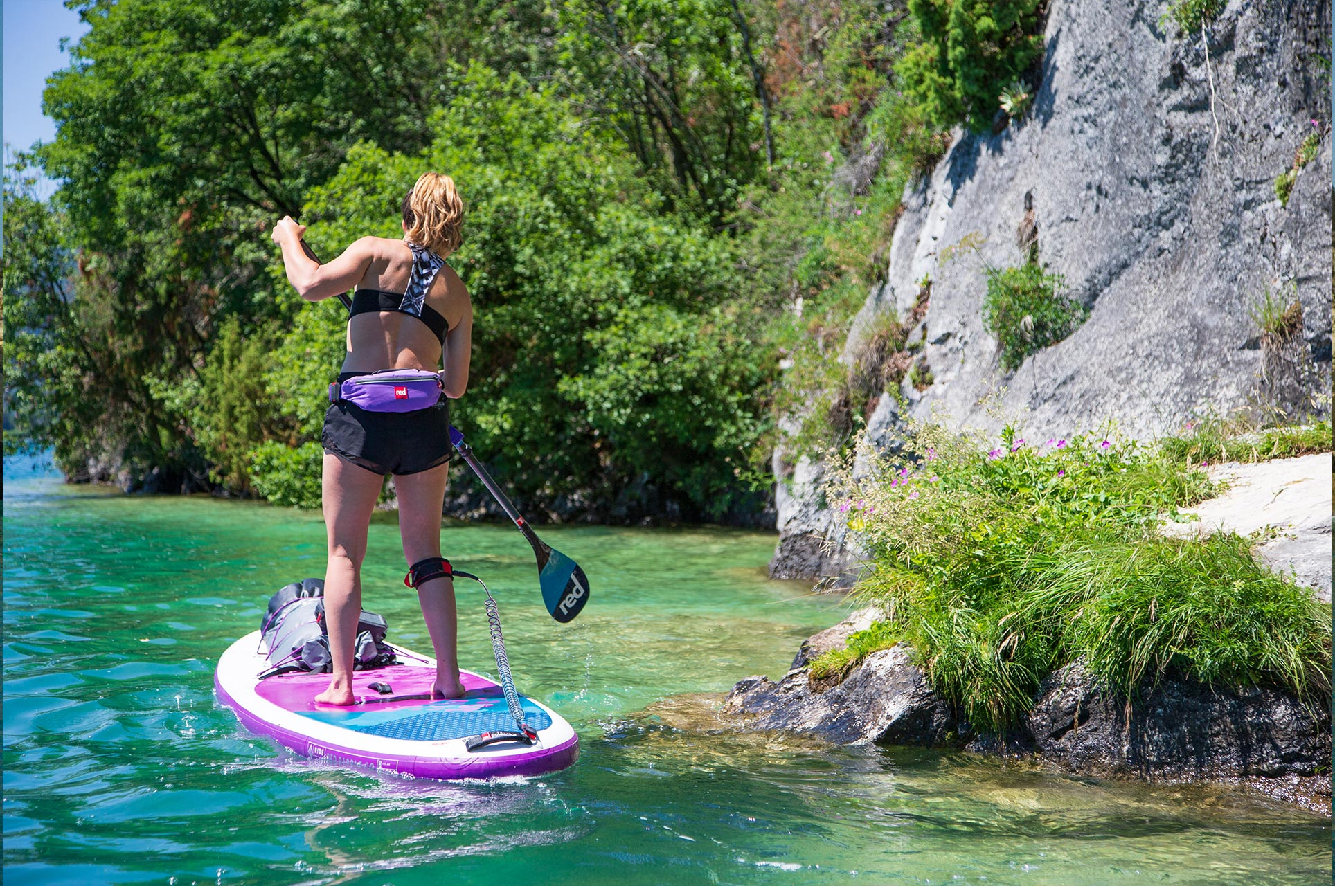 Female paddle boarder wearing Air Belt