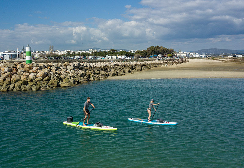 2 People Paddle Boarding On A Sunny Day
