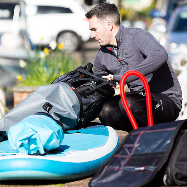 Male packing dry bag