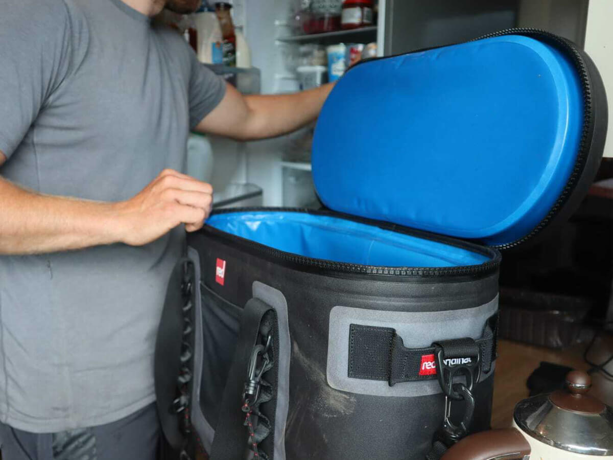 Ross Packing A Cooler Bag From the Fridge
