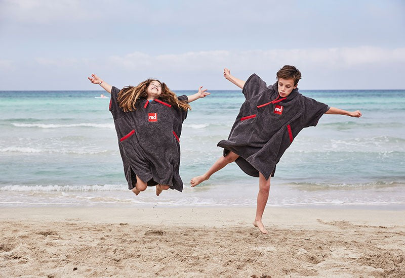 children wearing luxury kids poncho towel changing robe at beach