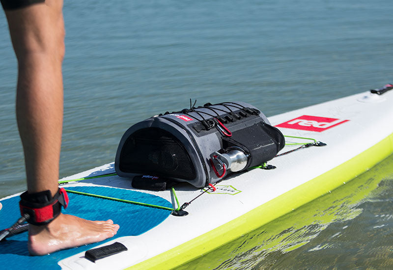 The Red Original Deck Bag & Water Bottle Attached To A SUP Board