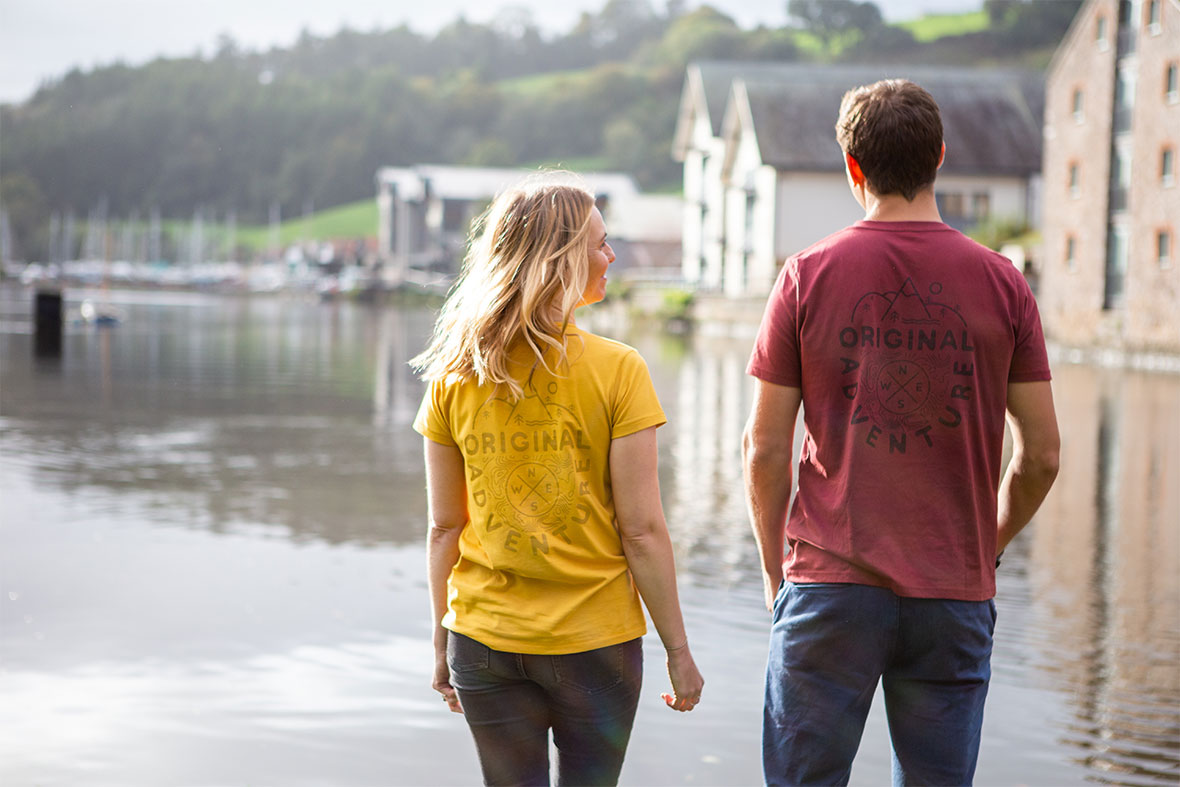 Man And Woman Wearing The Mustard Yellow & Red Wine T-shirts Looking Out At The Water
