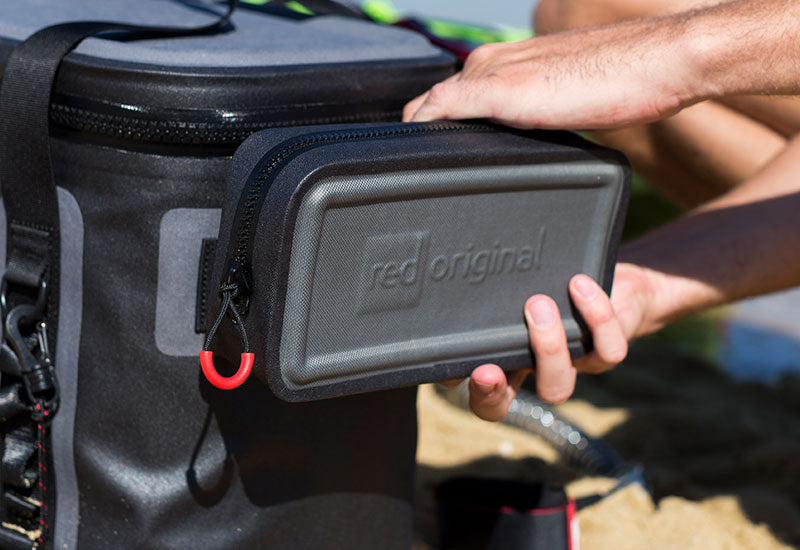 The Red Original Waterproof Pouch Attached To The Waterproof Cooler Bag
