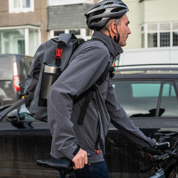 Cyclist Walking with his bike past a car