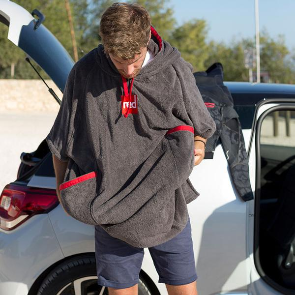 Man Getting Changed By His Car In A Red Original Towelling Robe