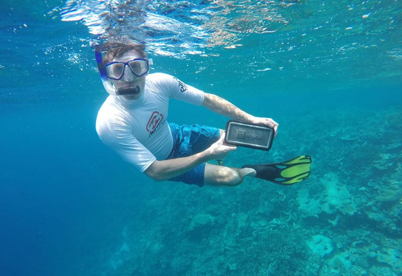 Taking the Red Original Waterproof Pouch underwater