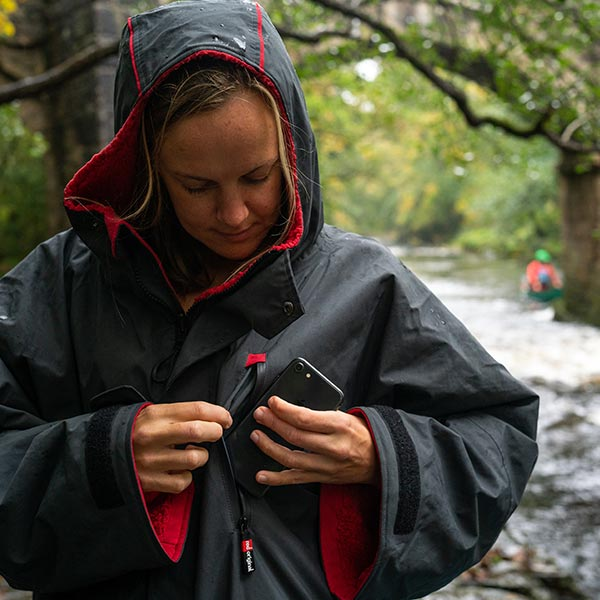 Woman wearing Waterproof changing robe with long sleeves