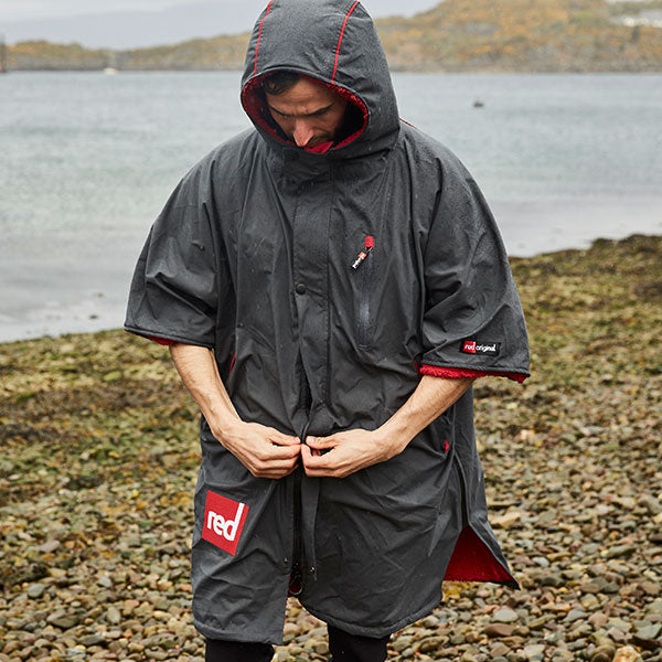 Man Wearing the  Red Original Pro Change Robe on a beach