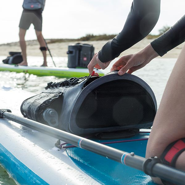 Red Original Deck Bag strapped to an inflatable paddle board