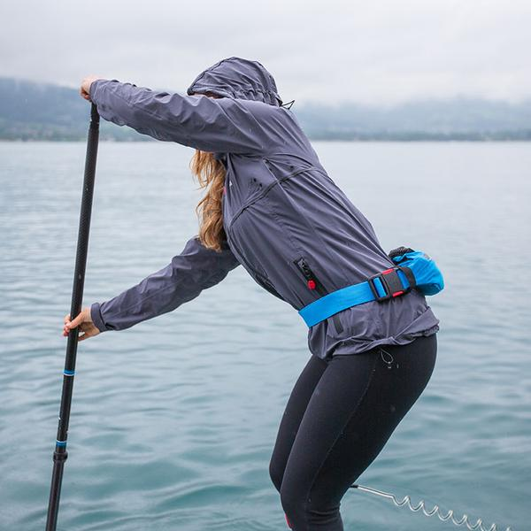 Woman on a paddle board in the rain