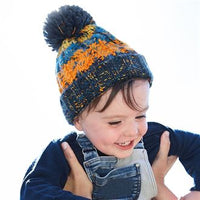 Infant/ junior corkscrew pom pom beanie
