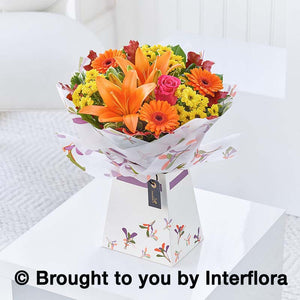 Seasonal Autumnal flowers, oranges, yellow and gold. Presented in a gift bag